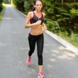 Woman running marathon race motion blur — Stock Photo