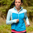 Stock Photo: Running womwith headphones outdoor