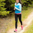 Stock Photo: Womjogging outdoor running countryside path