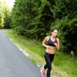 Stock Photo: Athlete womtraining for marathon run