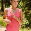 Stock Photo: Jogging womclose-up running in countryside