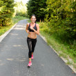 Stock Photo: Athlete womtraining for running race outdoor