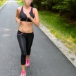 Sportive woman running outdoor motion blur — Stock Photo