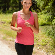 Stock Photo: Womjogging outdoor running on sunny day