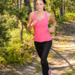 Stock Photo: Athlete womrunning through forest training