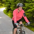 Stock Photo: Wommountain biking motion blur cycling path