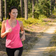 Stock Photo: Womrunning through forest outdoor training