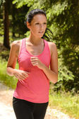 Jogging woman close-up running in countryside — Stock Photo