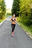 Athlete woman training for running race outdoor — Stock Photo