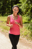 Woman jogging outdoor running on sunny day — Stock Photo