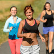 Friends jogging together outdoors sunny path — Stock Photo