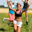 Cheerful friends jumping enjoy summer sport run — 图库照片