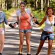 Stock Photo: Cheerful young women on roller skates outdoor