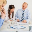 Business Team Discussing Document — Stock Photo #44192849
