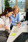 Businesswomen Discussing Graph In Office — Stock fotografie