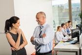 Business People Conversing In Office — Stock Photo