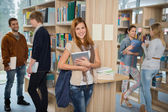 Group of students in college library — Stock Photo