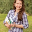 Student with braces holding books — Stock Photo