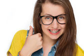 Girl with braces show thumb up — Stock Photo