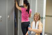 Woman in gym's locker room — Stock Photo