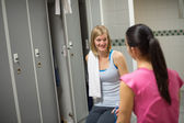 Woman with friend in changing room — Stock Photo