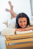 Woman relaxing on bed at spa — Stock Photo