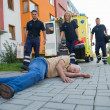 Paramedics giving help to injured man — Stock Photo #46252649
