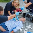 Paramedics examining man — Stock Photo #46252747
