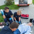 Paramedics treating injured man — Stock Photo #46252839
