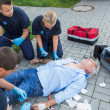 Emergency team giving firstaid to patient — Stock Photo #46252841
