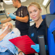 Paramedic helping patient in ambulance — Stock Photo #46253257
