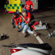 Paramedics assisting injured driver — Stock Photo #46253279