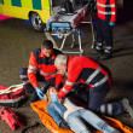 Emergency team helping injured driver — Stock Photo