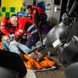 Paramedical team helping injured driver — Stock Photo #46253393