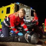 Paramedical team assisting injured driver — Stock Photo #46253511