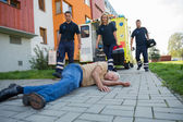 Paramedics giving help to injured man — Stock Photo