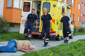 Paramedics arriving to unconscious man — Stockfoto