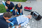 Emergency team giving firstaid to patient — Stock Photo