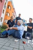 Emergency team helping patient on street — Stock Photo