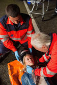 Paramedics removing helmet from driver — Stock Photo
