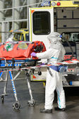 HAZMAT medical team member with stretcher — Stock Photo