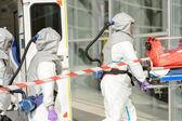 Medical team entering building — Stock Photo