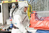 Biohazard medical team member with stretcher — Stock Photo