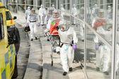 Biohazard medical team walking to building — Stock Photo