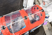 Biohazard team with virus patient in stretcher — Stock Photo