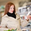 Shopping series - Red hair woman buying shampoo — Stock Photo #4683407