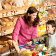 Grocery store shopping - Woman with child in winter outfit — Stock Photo #4684183
