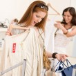 Fashion shopping - Two happy young woman choose clothes — Foto Stock #4691320