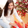 Happy woman wrapping Christmas present — Stock Photo #4695757