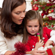 Mother with child opening present — Stock Photo #4696089